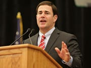 """Arizona Gov. Doug Ducey didn't keep his own Nikes in the closet on Independence Day, even though two days before he criticized the company for pulling its """"Betsy Ross"""" flag sneakers."""