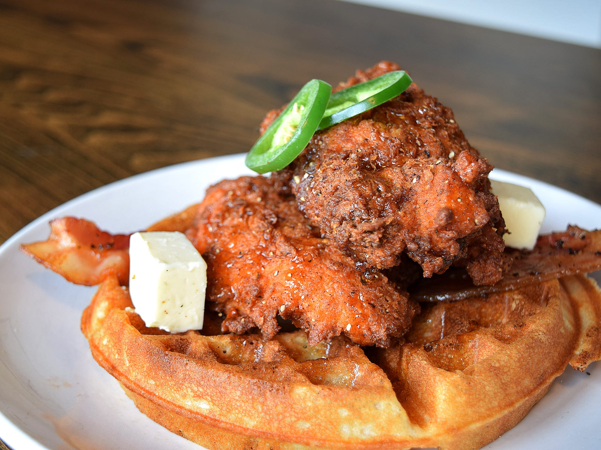 The spicy fried chicken & waffles at Thirsty Lion Gastro Pub & Grill.