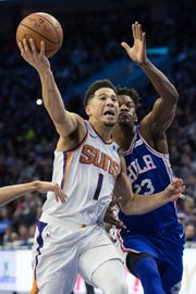 Nov 19, 2018: Phoenix Suns guard Devin Booker (1) drives against Philadelphia 76ers guard Jimmy Butler (23) during the second quarter at Wells Fargo Center.