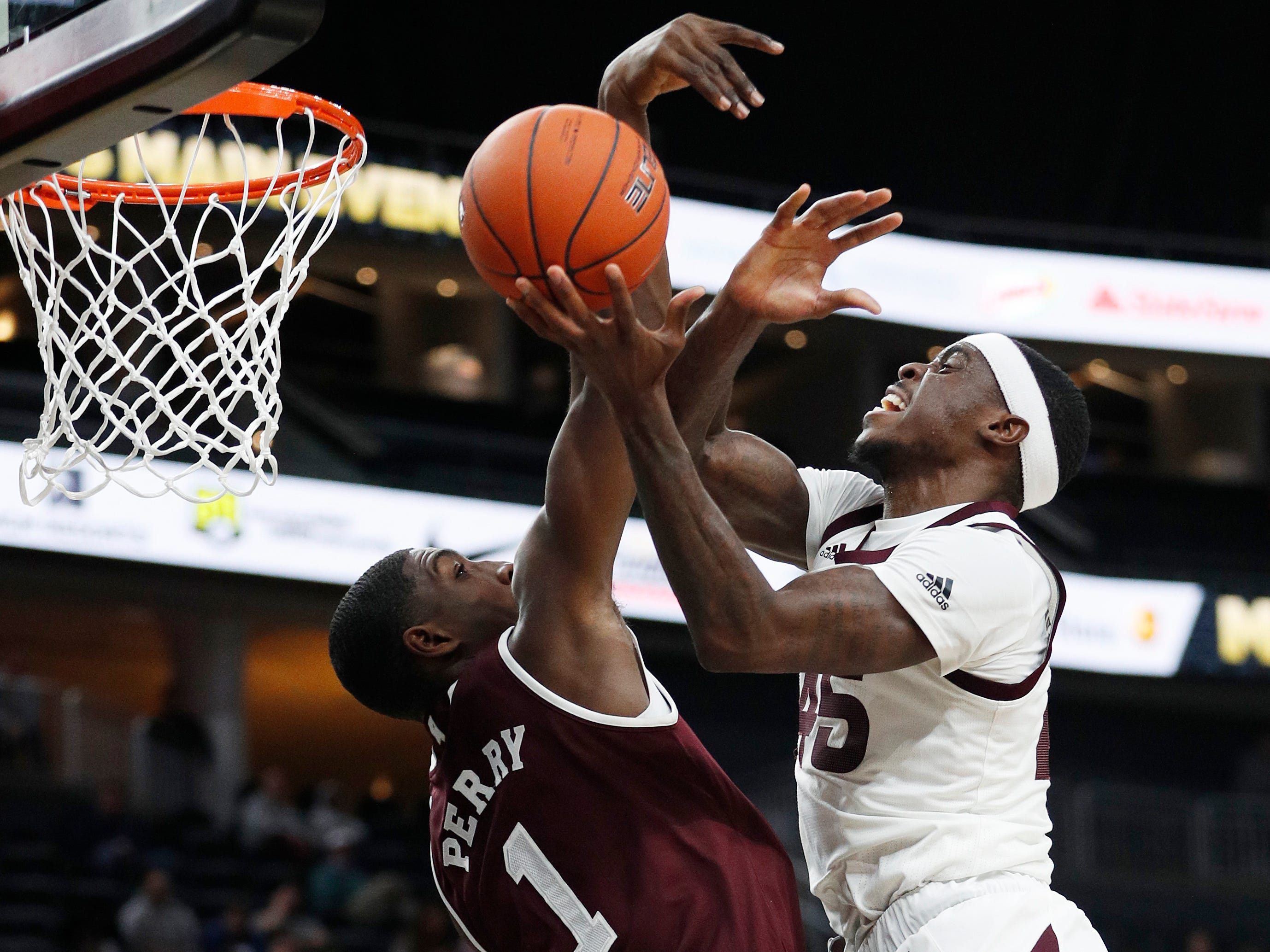 Arizona State's Zylan Cheatham (45) attempts a shot over Mississippi State's Reggie Perry (1) during the first half of a NCAA college basketball game, Monday, Nov. 19, 2018, in Las Vegas. (AP Photo/John Locher)
