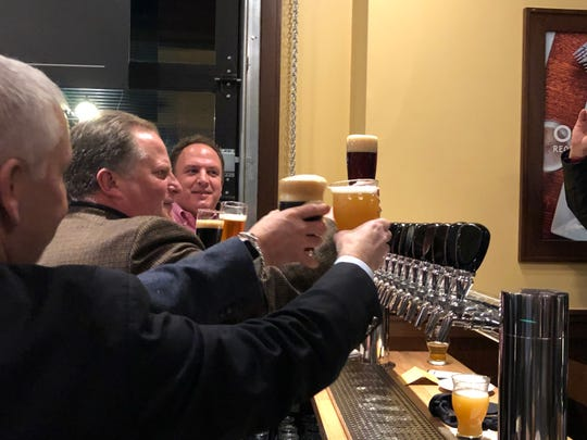 """Scenes from the ceremonial """"first pour"""" at the new Iron Hill Brewery & Restaurant in Hershey."""