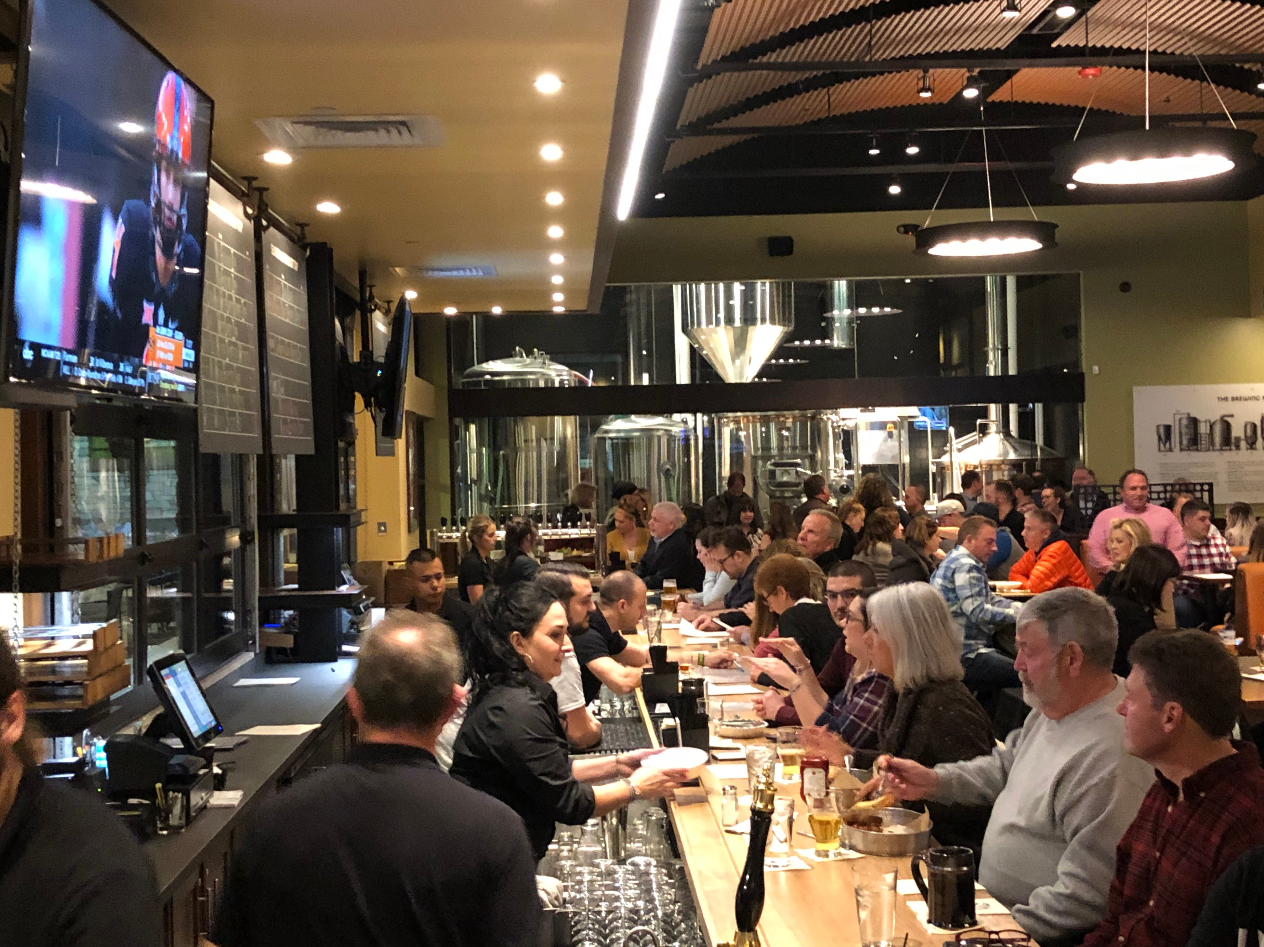 A packed house at the bar during the soft opening for Iron Hill Brewery & Restaurant.