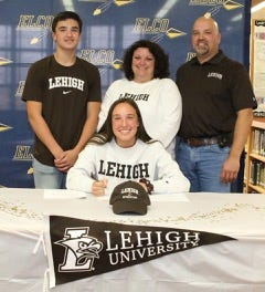 Elco senior soccer standout Ryelle Shuey signed her national letter-of-intent to attend Lehigh University on Monday during a signing event at Elco High School. With Shuey are her brother Rheece. mother Ashley, and father Ed.