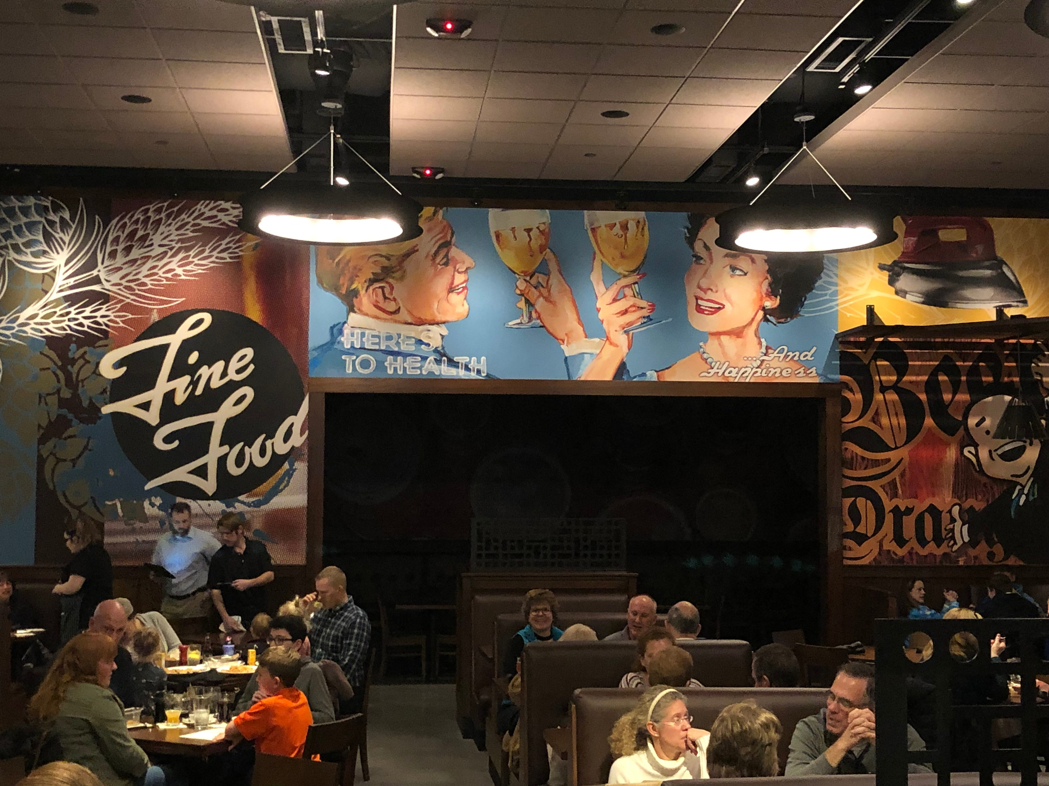 Cool murals give Iron Hill Brewery & Restaurant a fun vibe to go with its relaxed, casual atmosphere.