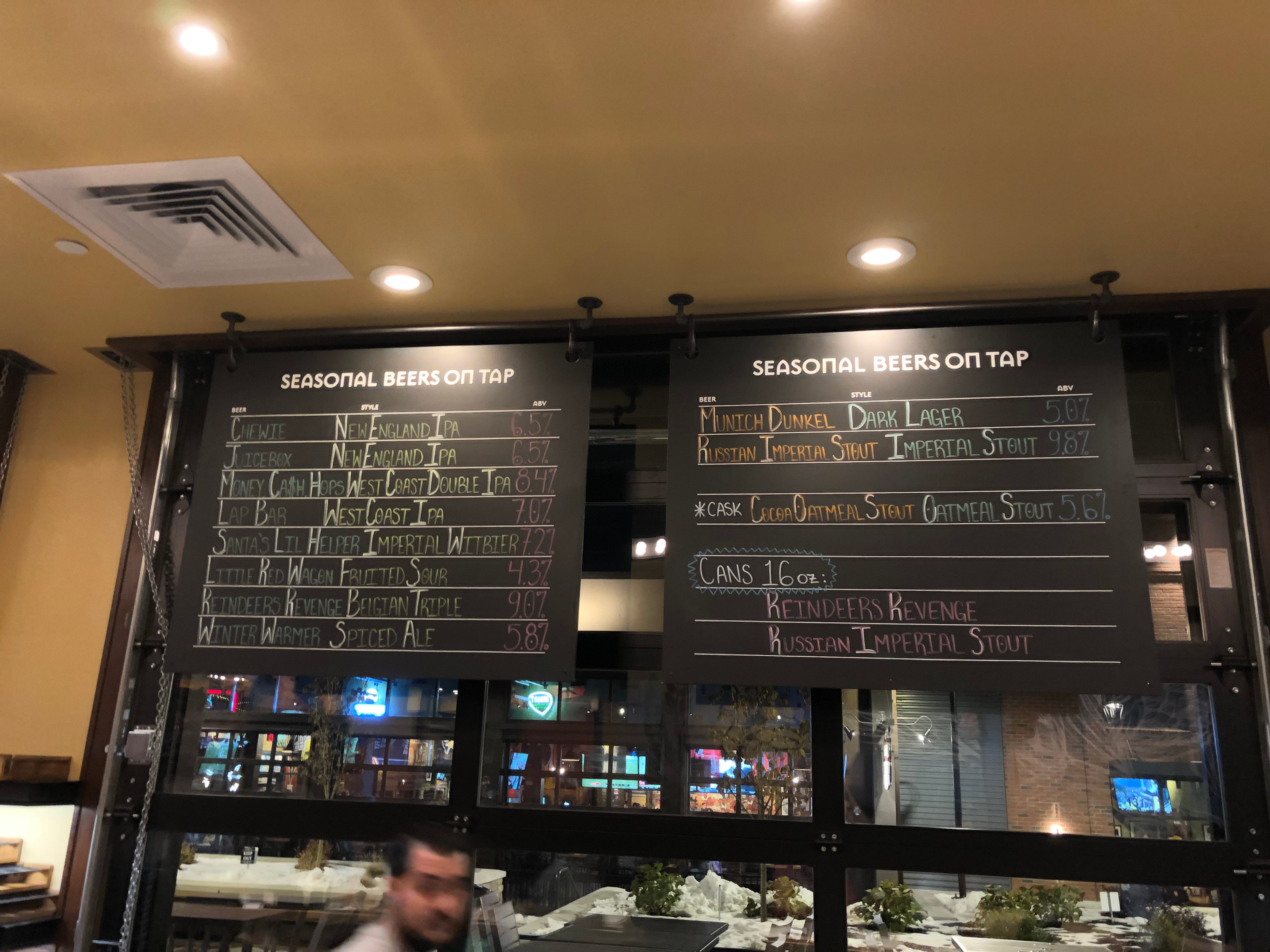The ever-changing list of seasonal beers at Iron Hill Brewery & Restaurant are written in chalk above the bar.