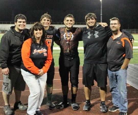 The Headlee family of Marine City poses for a photo after a high school football game.