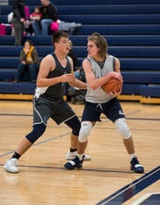 Richmond High School's Connor Cracchiolo (left) guards against Marysville's Brandon Moran during a scrimmage Tuesday, Nov. 20, 2018 at Marysville High School.