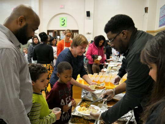 Volunteers and Poughkeepsie district staff serve a Thanksgiving feast to Morse Elementary School first-graders and their loved ones during its annual holiday celebration on Nov. 20, 2018.