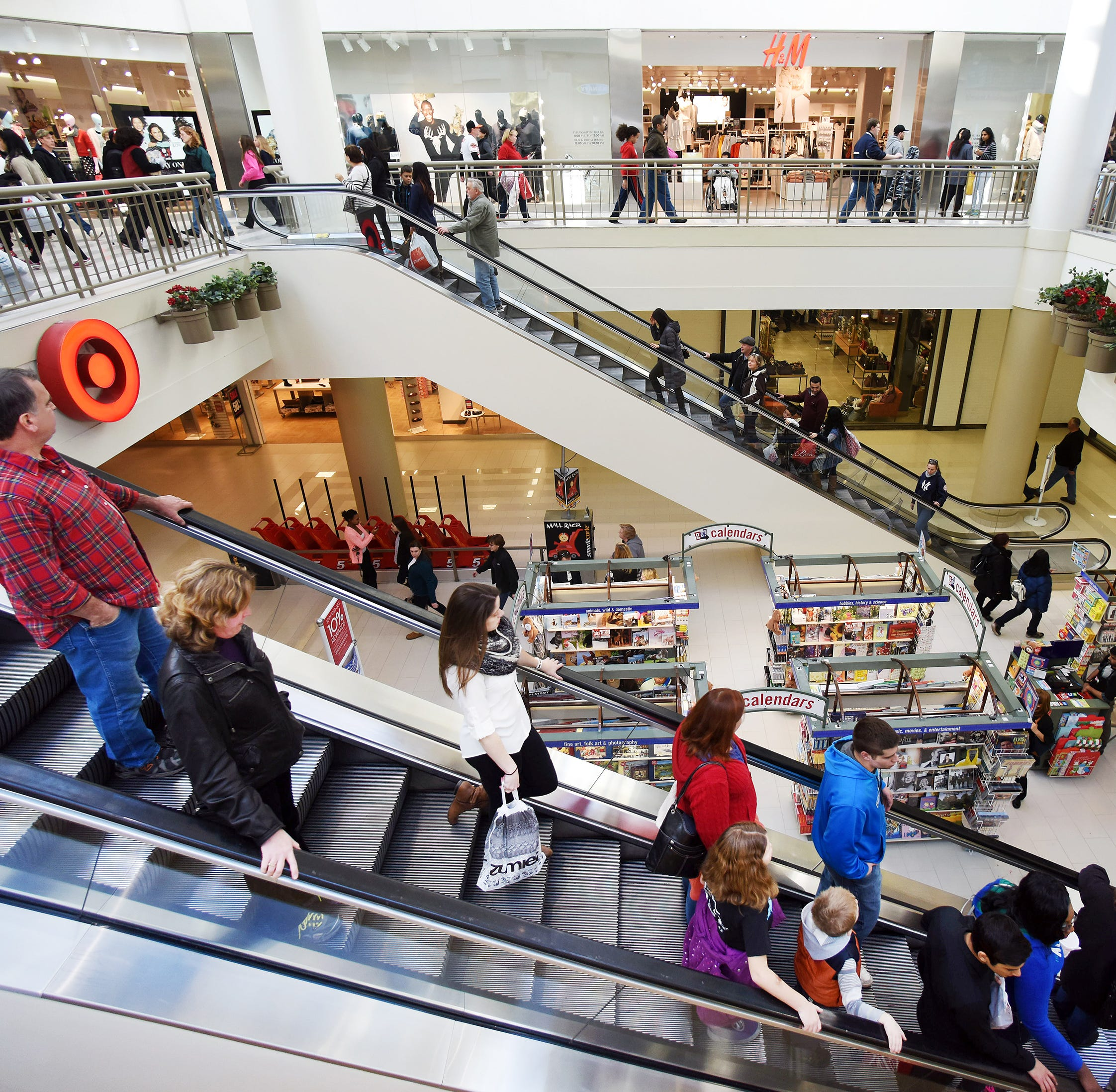 Bargain hunters shop at the Poughkeepsie Galleria in the Town of Poughkeepsie.