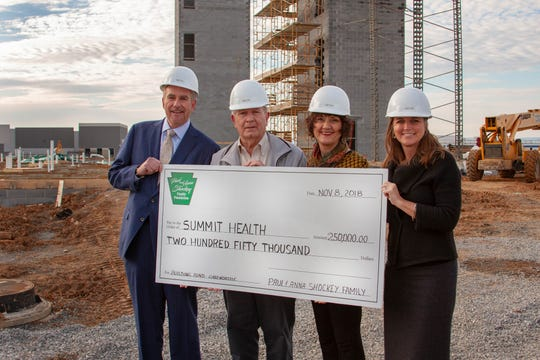 Ken and Bonnie Shockey (center) present a donation of $250,000 from the Paul and Anna Shockey Foundation to Pat O'Donnell (left) executive vice president of WellSpan Health and president and CEO of Summit Health, and Barbara Rossini (right), vice president for planning and community relations.