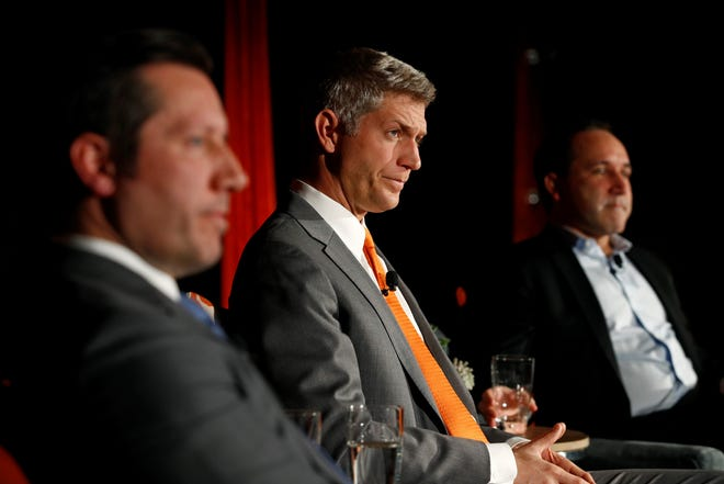 Mike Elias, center, the Baltimore Orioles' new executive vice president and general manager, attends a baseball news conference alongside Orioles ownership representative Louis Angelos, front left, and executive vice president John Angelos, on Monday, Nov. 19, 2018, in Baltimore. There has been recent speculation that the Orioles may be moving to Nashville, Tennessee. John Angelos has a home in Nashville.