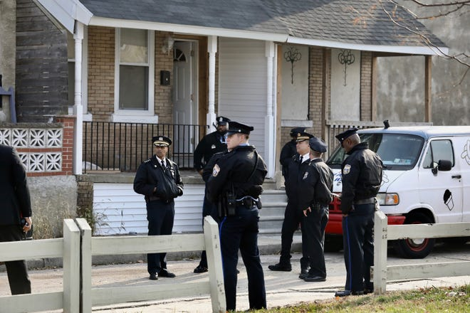 Philadelphia police outside row house on 5100 block of Malcolm in West Philadelphia site of a multiple homicide on Monday afternoon, Nov. 19, 2018. (David Swanson/The Philadelphia Inquirer/TNS)