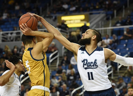 Nevada's Cody Martin, shown this season against California Baptist, is the Mountain West's assists leader.