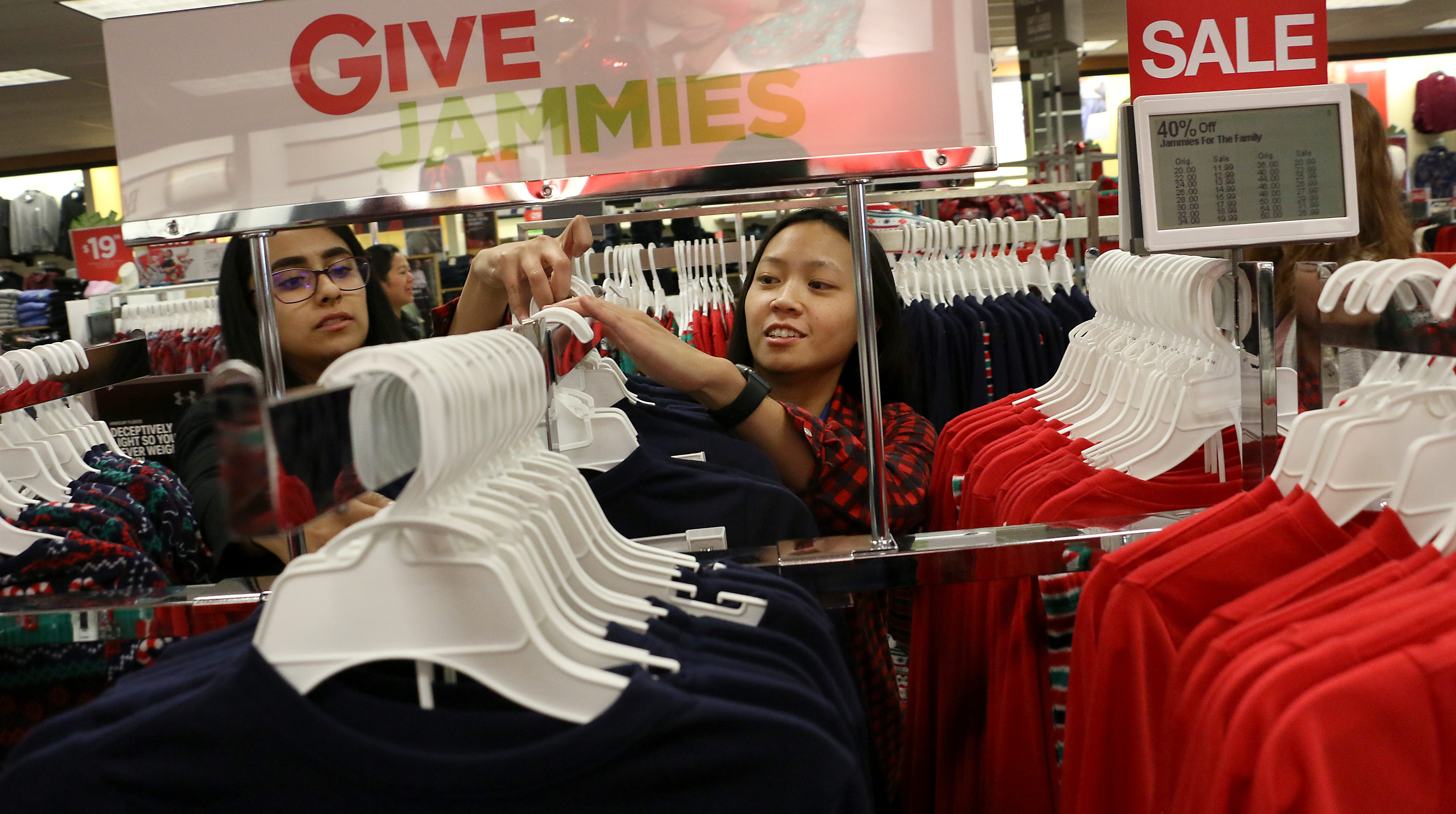 From right, employees Melanie Cabanilla and Emelyn Carias arrange some pajamas while getting ready for Black Friday sales at Kohl's in Spanish Springs on Nov. 15, 2018.