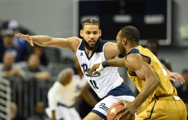 Nevada's Cody Martin defends against California Baptist earlier this season. The 8-0 Wolf Pack plays Friday against Arizona State.