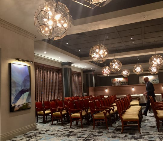 The dining room at the new Ruth's Chris Steak House in the Silver Legacy, shown here arranged for staff training, features starburst fixtures and images of local landmarks.