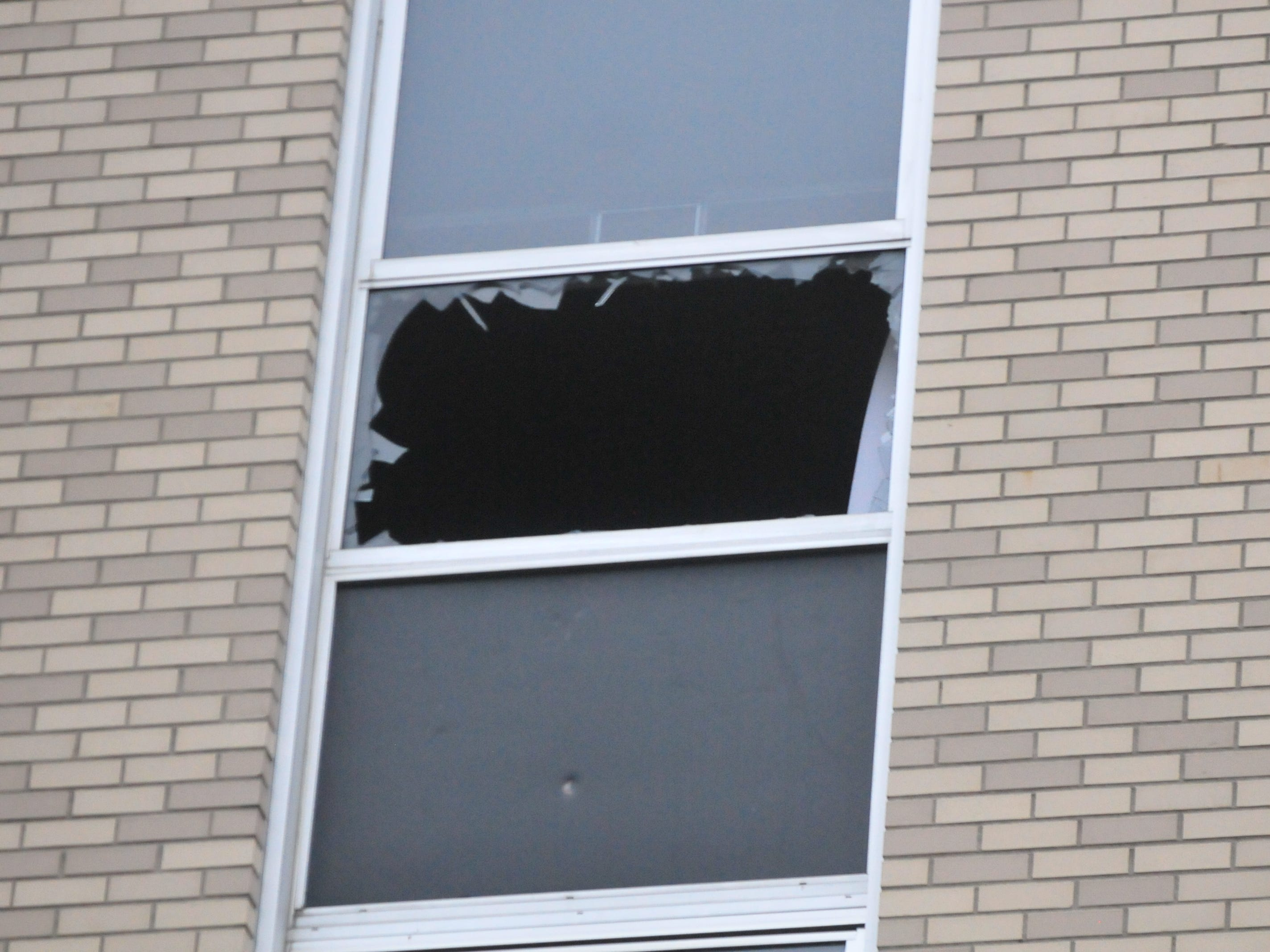 A window was broken during Monday's fire at Interfaith Apartments.