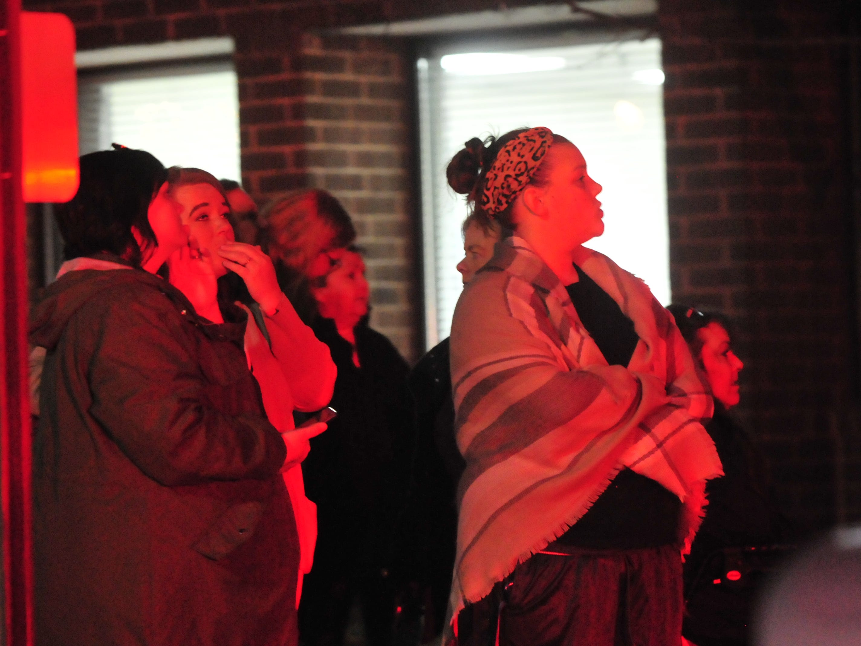 Residents and others watch as Richmond Fire Department fought a fire Monday evening at Interfaith Apartments.