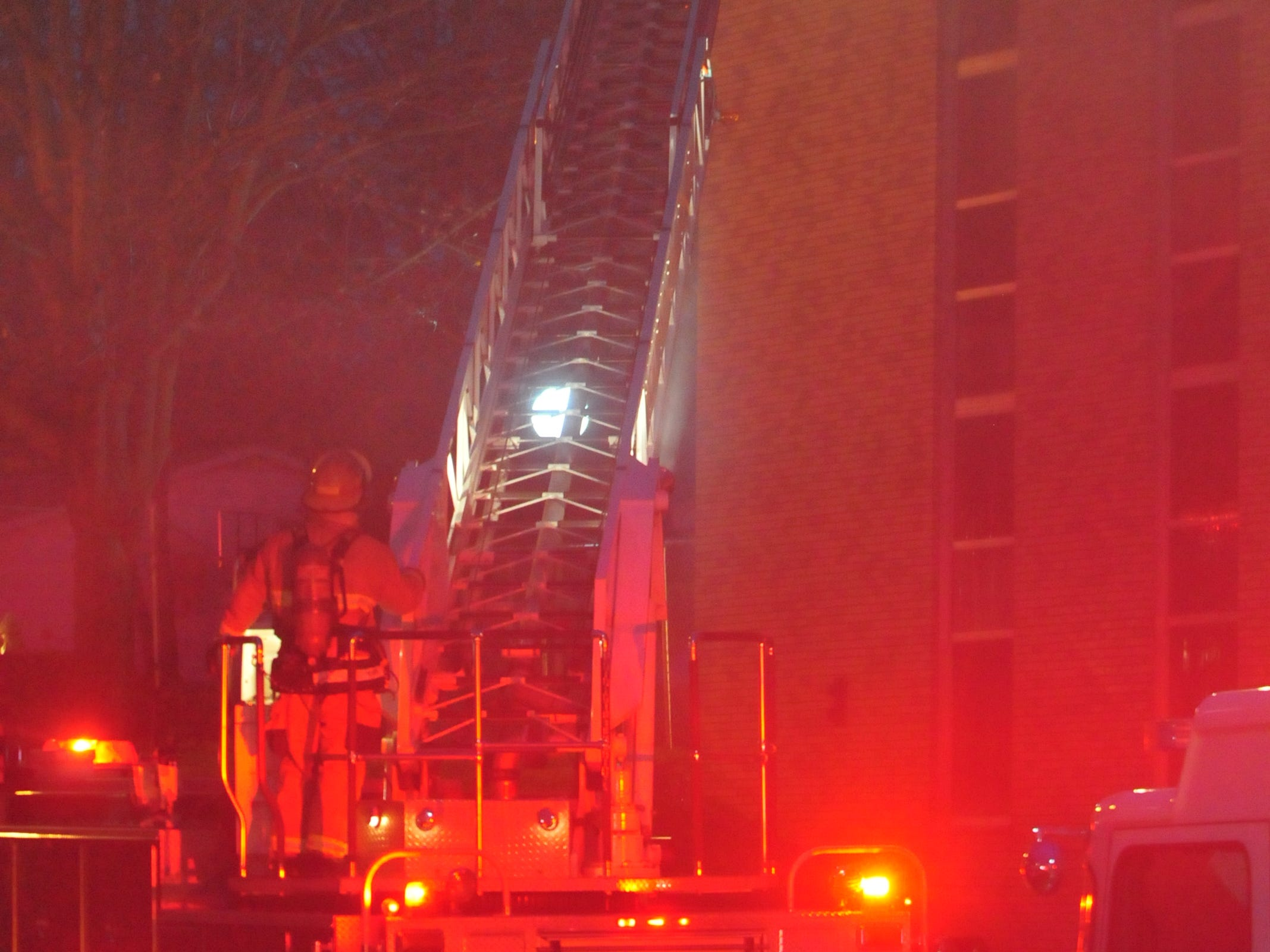 Richmond Fire Department personnel work to extinguish a fire Monday evening at Interfaith Apartments.
