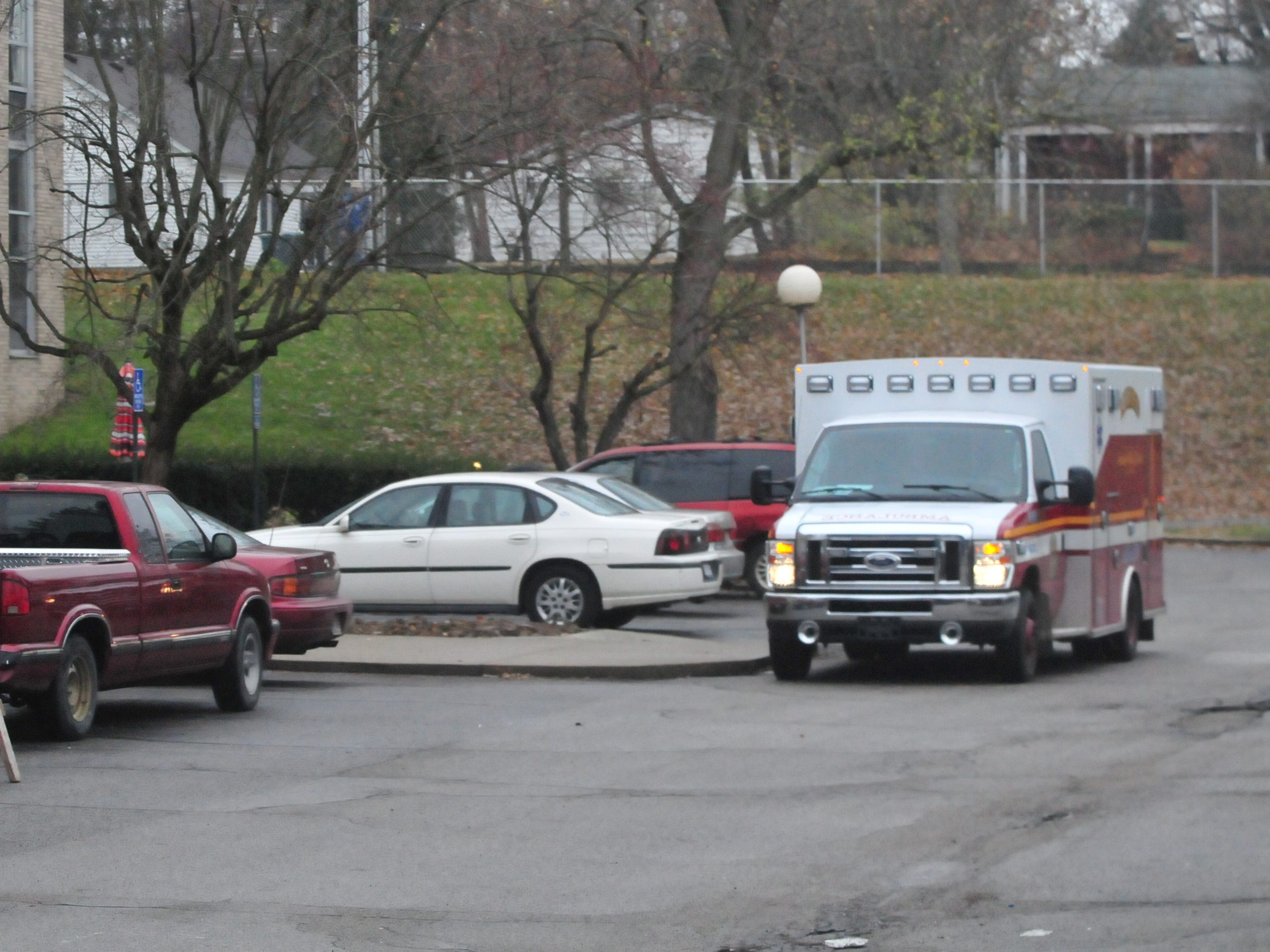 An ambulance is staged Tuesday morning outside Interfaith Apartments as Richmond Fire Department personnel worked on the investigation into Monday night's fire.
