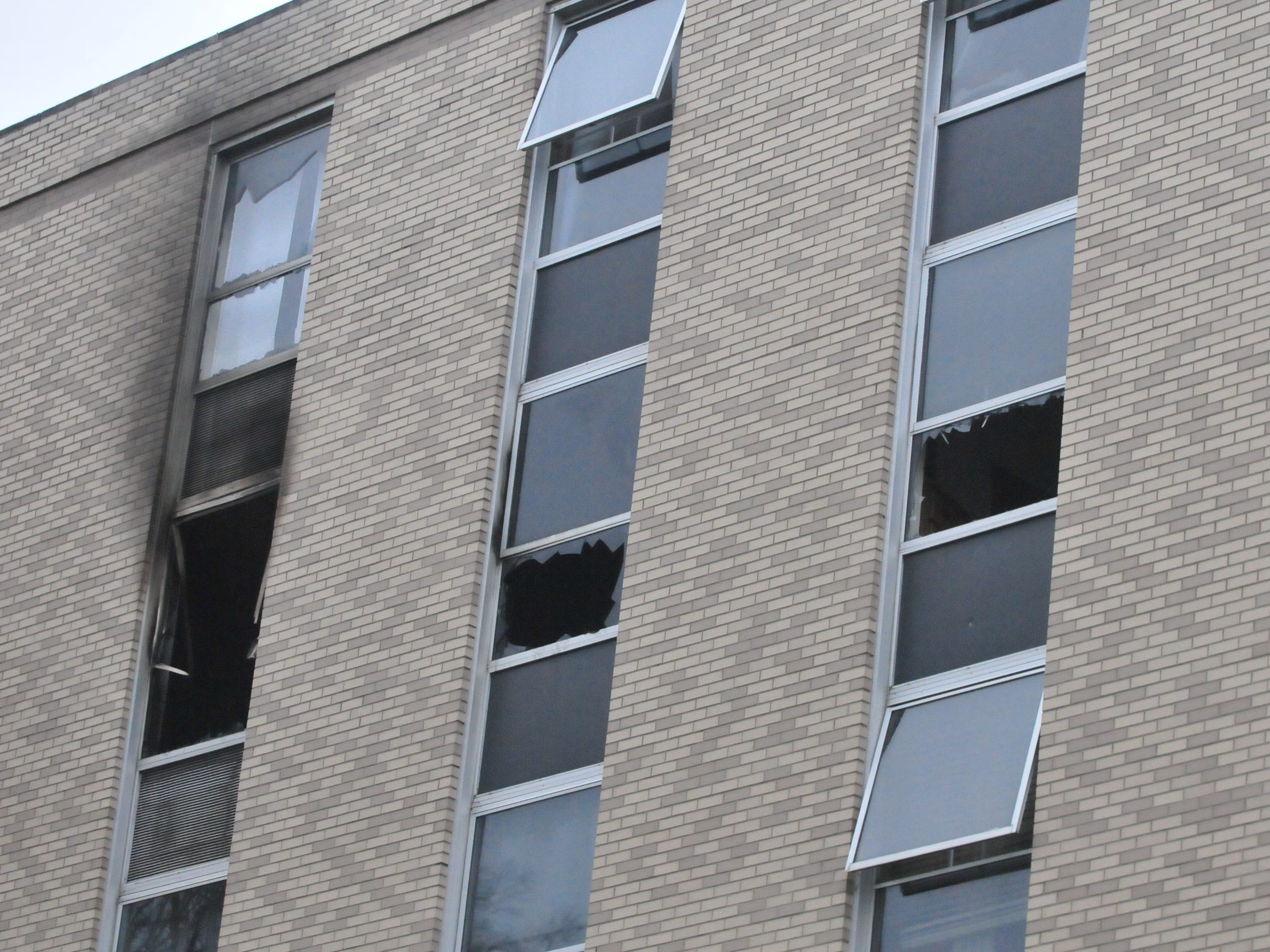 Broken windows and soot show where a Monday fire burned inside apartment 518 of Interfaith Apartments' North Building.