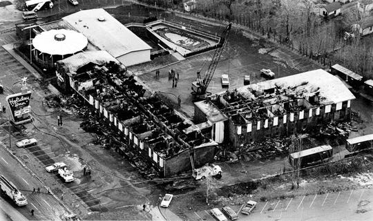 Air view of burned Greece Holiday Inn, looking northwest. (Kevin Higley photo, 11/26/1978) TU 11/27/1978