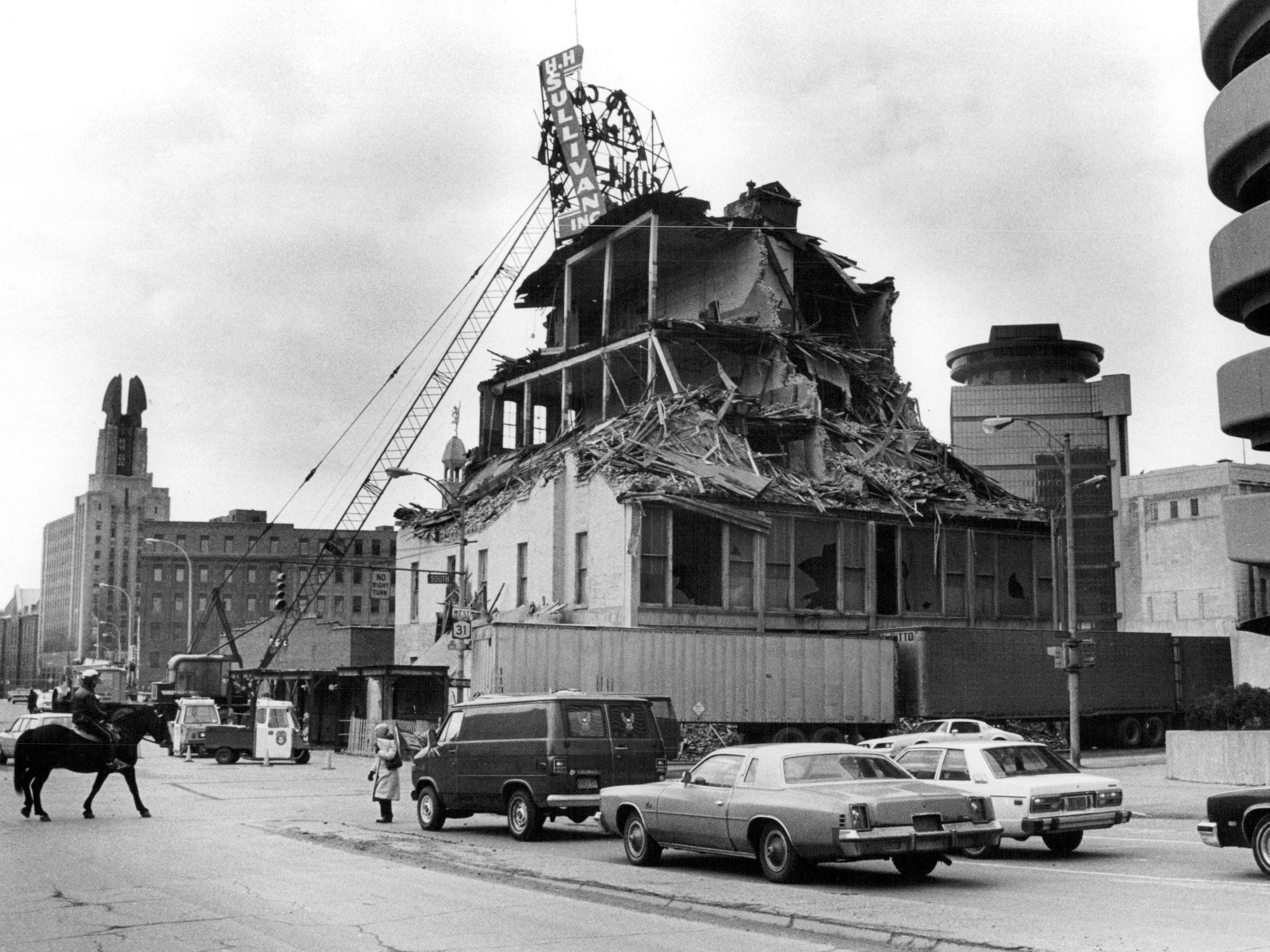 In this 1981 photo, the H.H. Sullivan building on the corner of Broad Street and South Avenue is torn down. At far right is the South Avenue parking garage. The H.H. Sullivan building was located directly across from the Rundel library. The area beyond the horse is the Broad Street bridge.