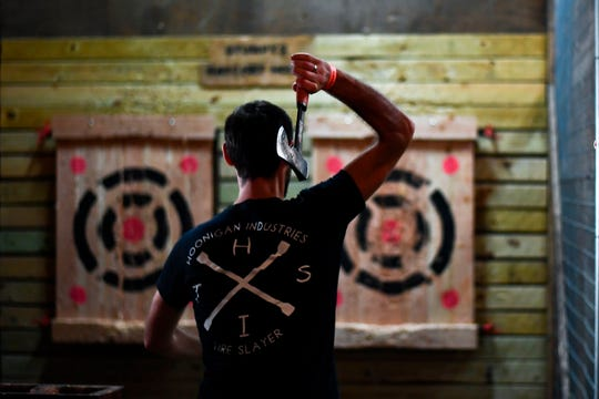 Ax-throwing club Axes and Ales opens Wednesday, March 27, at 349 East Ave.