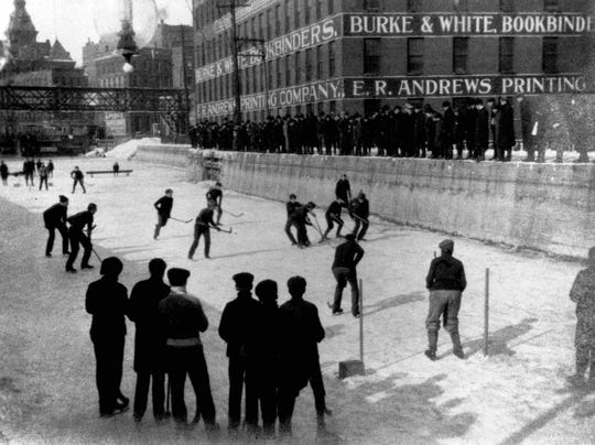 In 1903 the Erie Canal lay where Broad St. is today. Boys played hockey on it and the Aqueduct Building (right background) at the west end bore the names of two companies that became parts of Lawyers Co-operative Publishing Co.