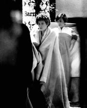 Survivors warm themselves in blankets at Genesee Plaza Holiday Inn downtown, where they were taken from Greece Holiday Inn after fire destroyed the hotel. (Bob Gapsky photo, 11/1978) TU 11/27/1978