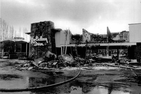 View of the burned-out front of Greece Holiday Inn from Ridge Road. (Peter Weinberger photo, 11/26/1976)