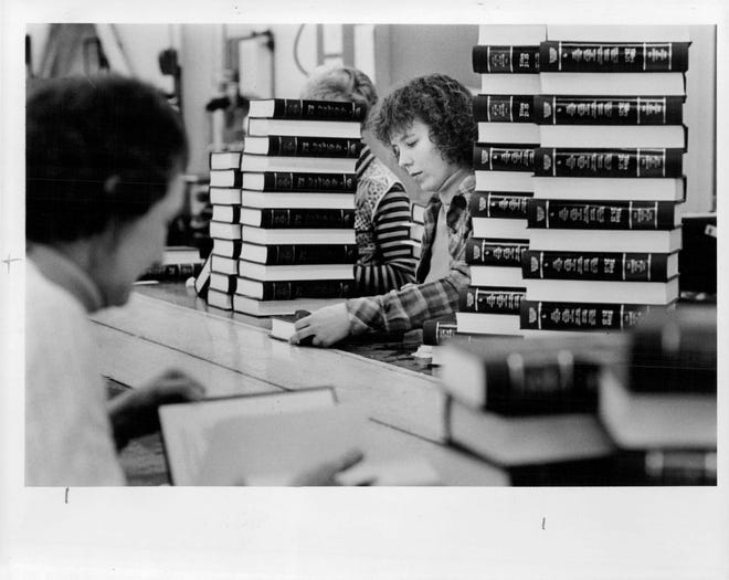 Wanda Hammond inspects newly bound law books in the Webster printing plant of Lawyers Co-operative Publishing Co. in1980.