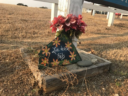 A memorial at the entrance to Rancho Tehama serves as a reminder of the shooting that happened there exactly a year ago.