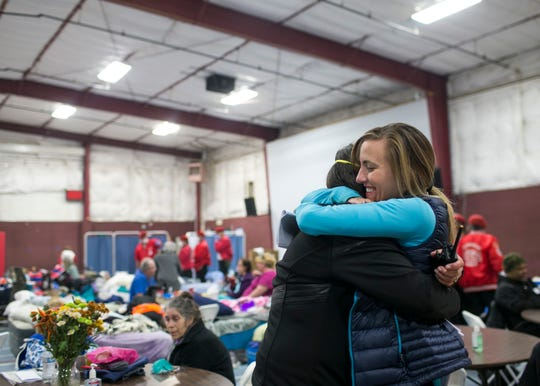 ER nurse Birgitte Randall, right, hugs a volunteer at the East Avenue Church Shelter in Chico, California, on Nov. 17, 2018. Randall fled her burning hospital Feather River in Paradise as the Camp Fire raged through town, eventually destroying her home. Responding to a Facebook request for help at the East Avenue Shelter, Randall and several of her colleagues and friends quickly sprung to action, starting a pop-up clinic at the shelter to aid evacuees in need of medical attention.
