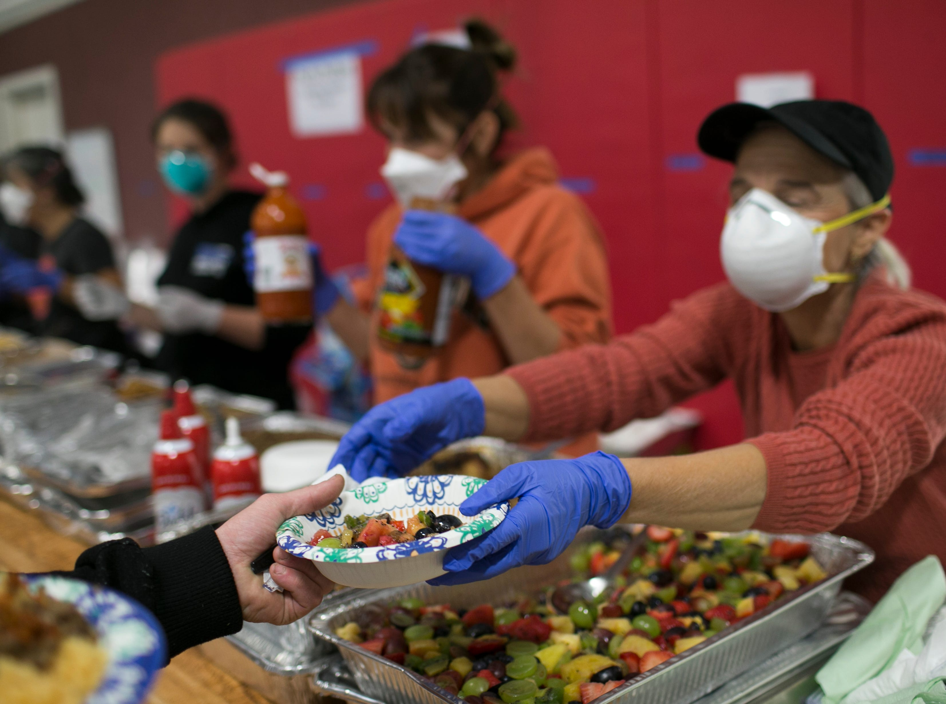 Dinner is passed out by volunteers to Camp Fire evacuees at the East Avenue Church Shelter in Chico, California on November 16, 2018.