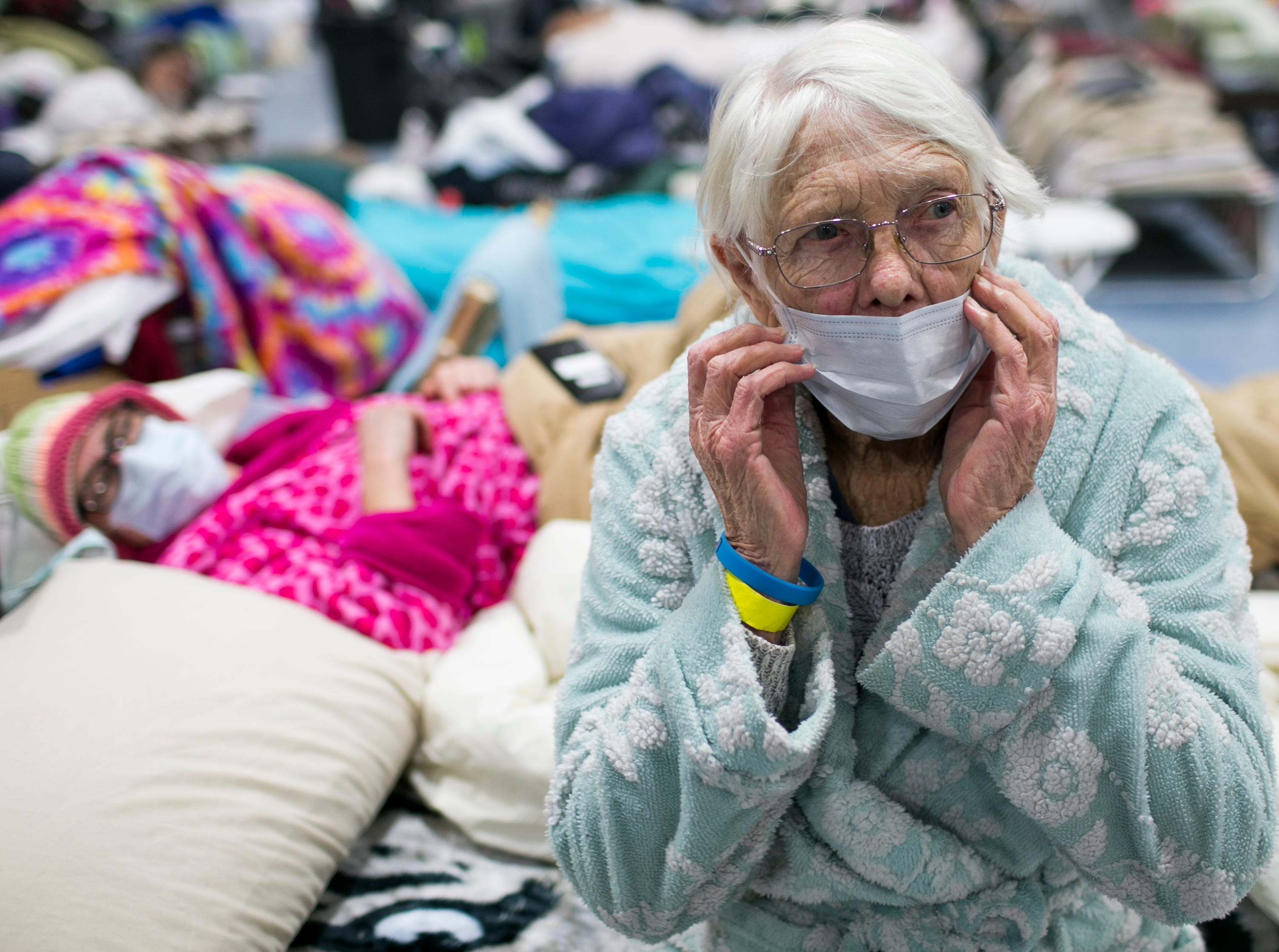 85-year-old Minna Anderson, right, sits on a bed next to her daughter Libby Andersen, left, at the East Avenue Church Shelter in Chico, California, on Nov. 15, 2018. The two lost everything when the Camp Fire took over their home in Paradise, forcing them to flee.