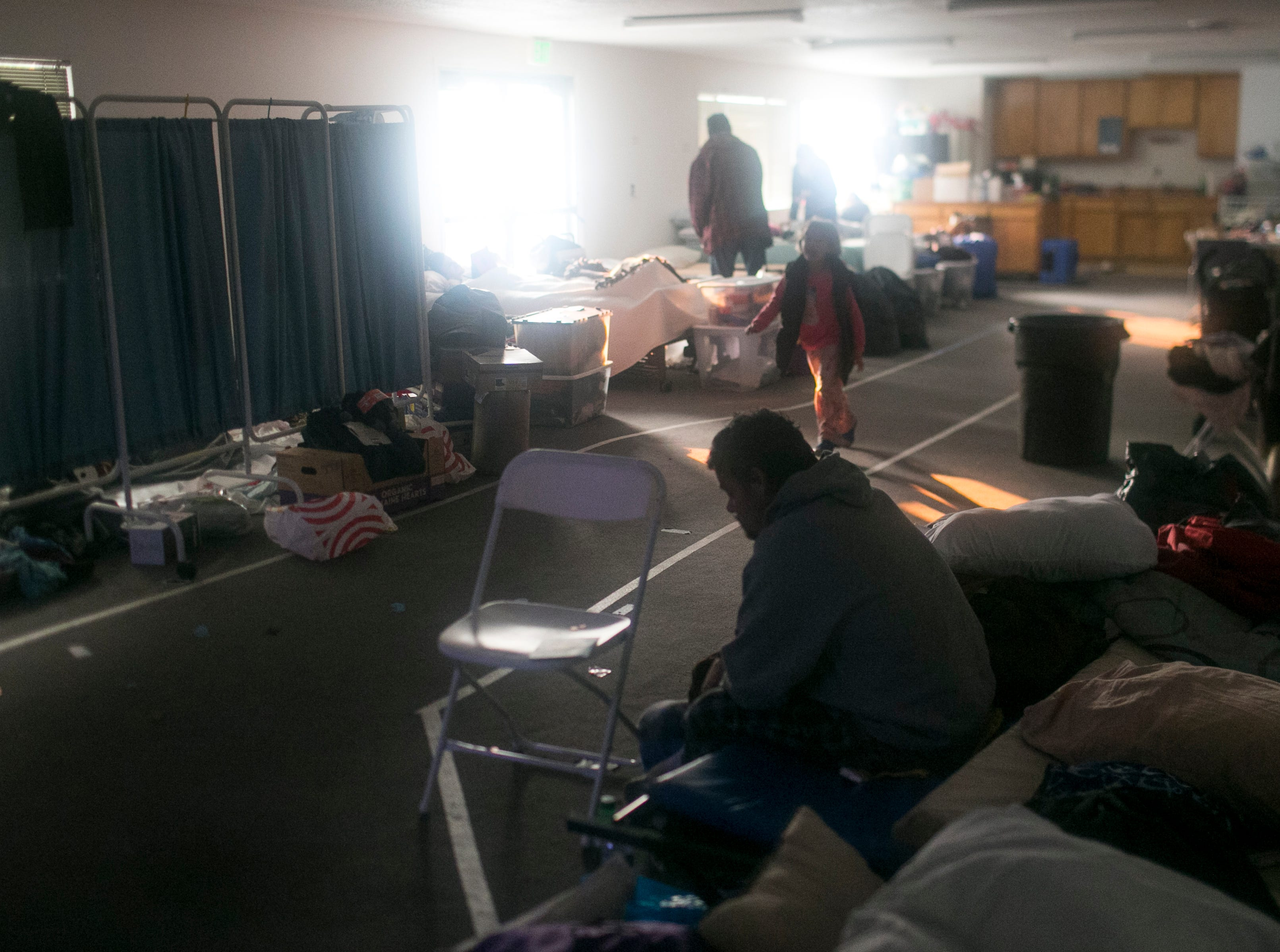 Families evacuated from the town of Paradise in the Camp Fire stat their day at the East Avenue Church Shelter in Chico, California on November 16, 2018.