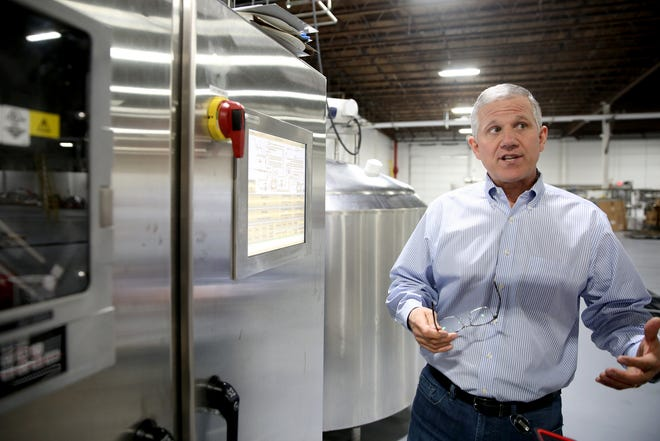 Chris Sarles, president and CEO of Oregon Fruit Products, explains operations at the company's new home off Madrona Avenue SE in Salem. The canned fruit company had been in West Salem since 1935.