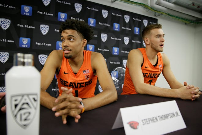 Oregon State's Stephen Thompson Jr., left, and Tres Tinkle lead Oregon State to a 74-58 win over Penn in the third-place game of the Paradise Jam tournament.