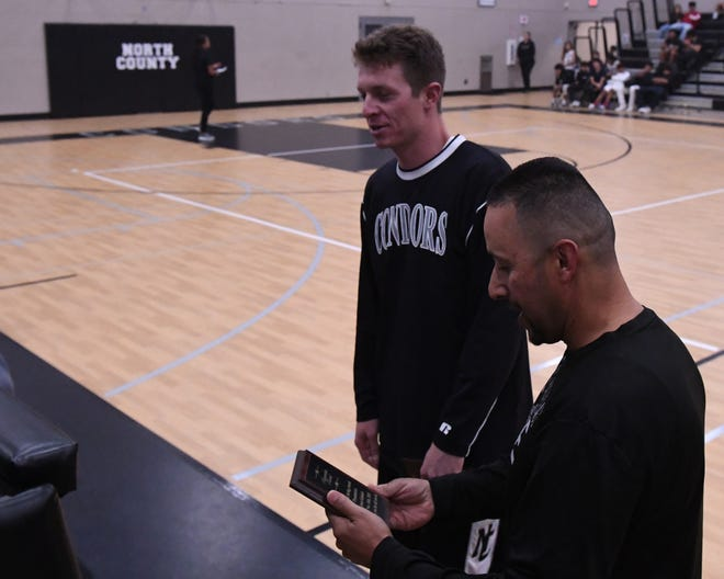 Austin Self (left) and Jesus Galindo received plaques during the North Monterey County High School's boys' basketball alumni game.