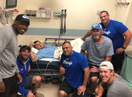 Lake View senior David Tanguma had emergency surgery during the first week of the football season. The Lake View coaching staff visited him. They are, from l-r, Richard Covington, Chad Kinney, Hector Guevara, Gerald Butts, Cameron Massengill and Ben Lyons.