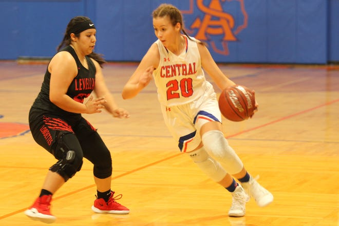 San Angelo Central High School's Anjelina Humphreys tries to make a move past a Levelland defender during a girls basketball game at Babe Didrikson Gym on Monday, Nov. 19, 2018.