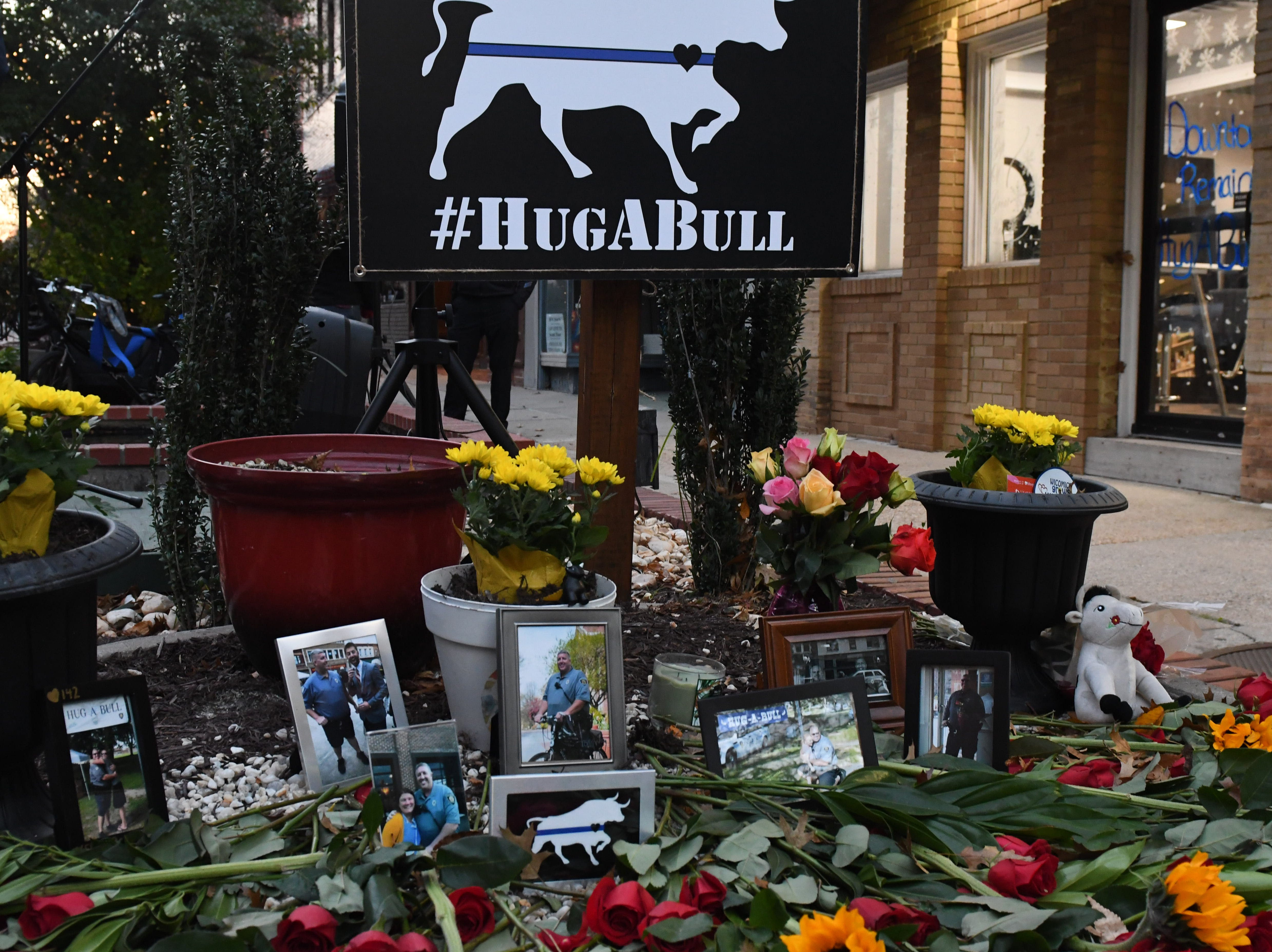 """A memorial has been made in downtown Salisbury to  honor Salisbury Police Officer Aaron """"Bull"""" Hudson who died unexpectedly while off duty on Tuesday, Nov. 20, 2018."""