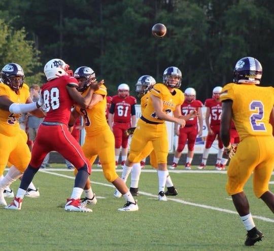 Logansport quarterback Landon Moon fires a pass to Madrid Johnson Jr. during a game earlier this season.