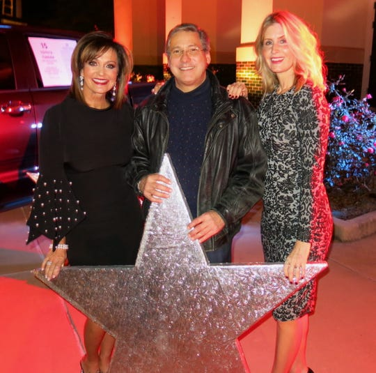 Christmas in the Sky Chief Waynette Ballengee, a Top Sponsor Dr. Mike Acurio, Sky Co-Chair Heidi Kallenberg at Sky Sponsor Party, which starred the three of them.