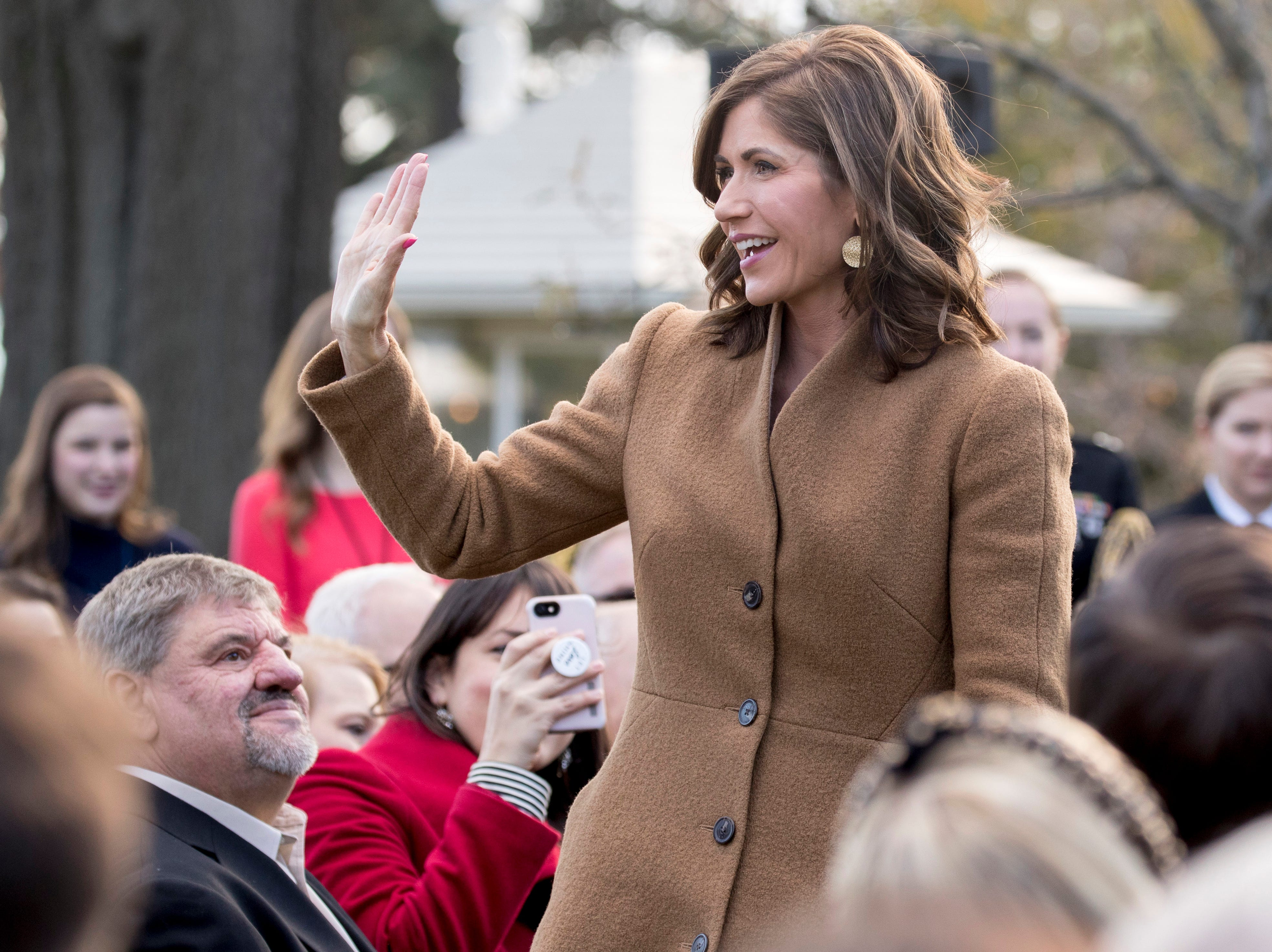 South Dakota Governor-elect Kristi Noem waves as she is recognized by President Donald Trump during a ceremony to pardon the National Thanksgiving Turkey in the Rose Garden of the White House in Washington, Tuesday, Nov. 20, 2018. (AP Photo/Andrew Harnik)