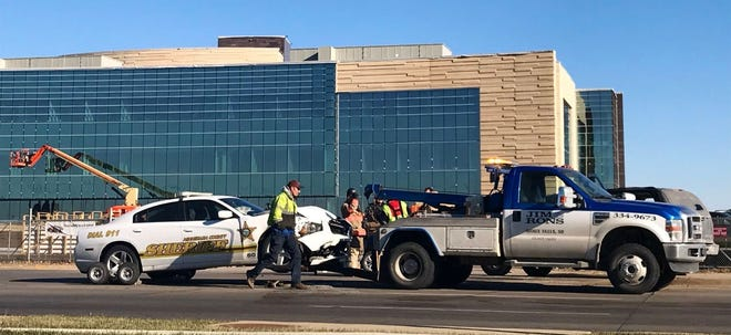 A Minnehaha County Sheriff's Office vehicle is towed near 69th Street and Louise Avenue in Sioux Falls after it was involved in a crash on Tuesday, Nov. 20, 2018.