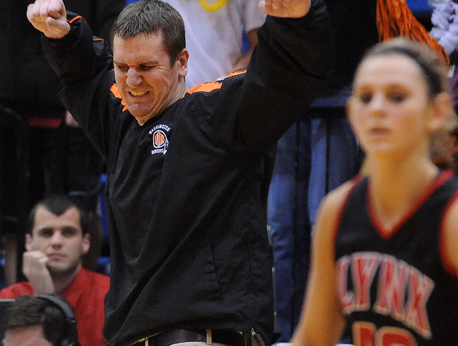 Washington Warrior head coach, Nate Malchow celebrates his team's 61-50 win over Brandon Valley Friday night in the girls class AA basketball semifinals at Frost Arena in Brookings, March 9, 2012. 
