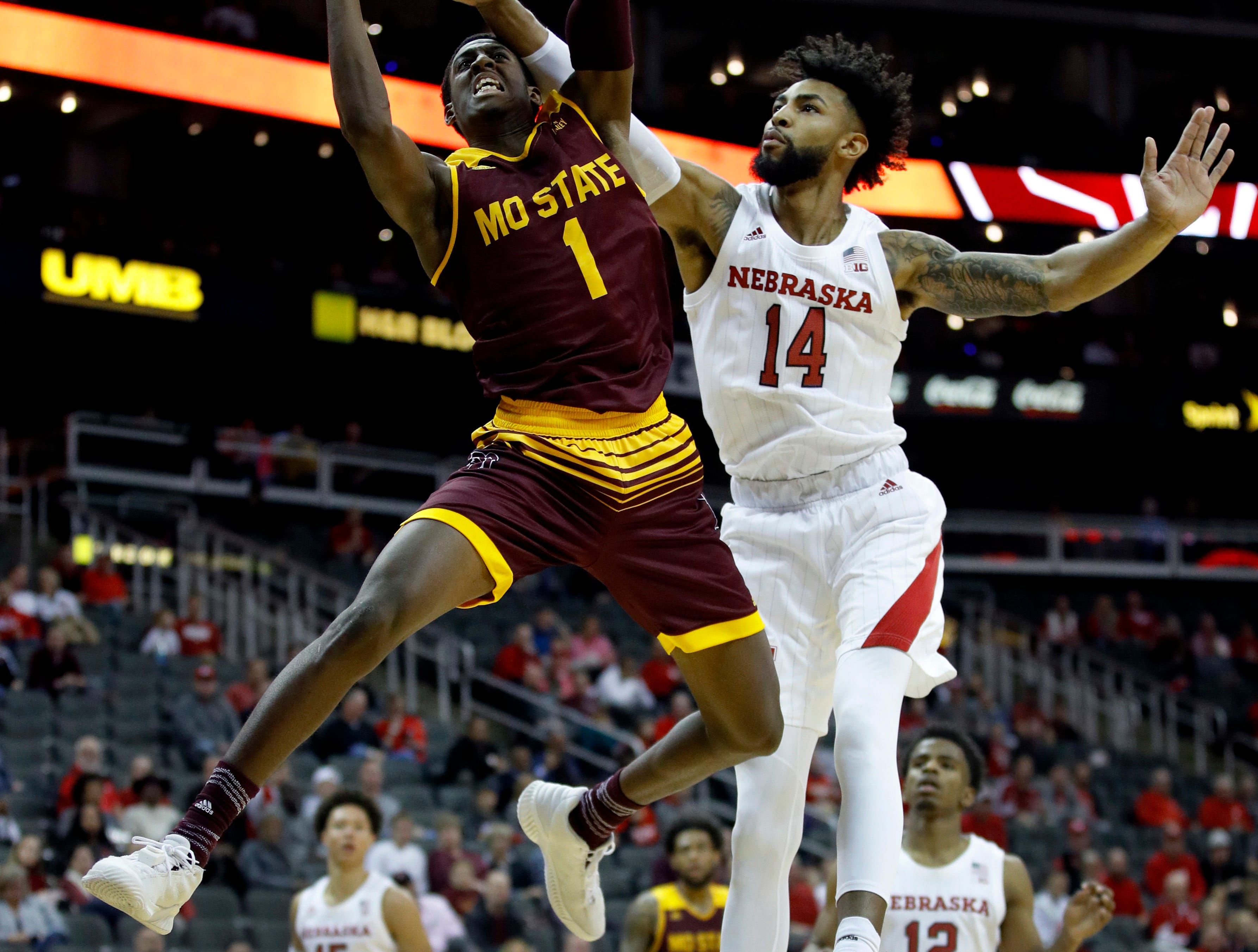 Nebraska's Isaac Copeland Jr. (14) tries to block a shot by Missouri State's Keandre Cook (1) during the second half of an NCAA college basketball game Monday, Nov. 19, 2018, in Kansas City, Mo. Nebraska won the game 85-62. (AP Photo/Charlie Riedel)
