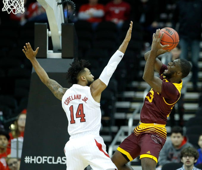 Missouri State's Kabir Mohammed (23) shoots over Nebraska's Isaac Copeland Jr. (14) during the first half of an NCAA college basketball game Monday, Nov. 19, 2018, in Kansas City, Mo. (AP Photo/Charlie Riedel)